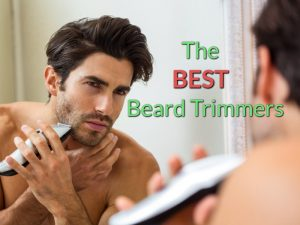 The Featured Image of the Best Beard Trimmers review article showing a man standing in front of the mirror grooming his beard with a trimmer